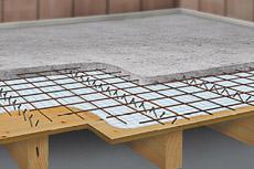Vývoj a použití dřevobetonových kompozitních prefabrikovaných dílců v pozemním stavitelství