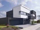 Skulpturální pojetí rodinného domu v Kolíně nad Rýnem za použití systémového řešení Schüco AWS 70.HI