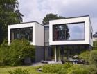"""Rodinný dům s """"terasovitým"""" interiérem s okenními a fasádními systémy Schüco"""