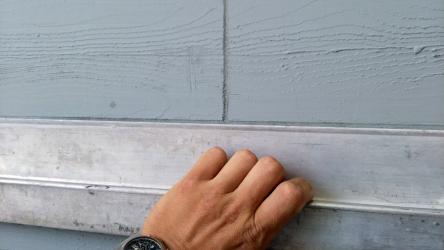 Omítka imitující dřevo na fasádě horských apartmánů – spárování