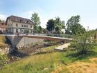 Příklad spřaženého dřevobetonového mostu, lávka ve Švábském Gmündu, navržená firmou SCHAFFITZEL + MIEBACH Faszination Brücken GmbH