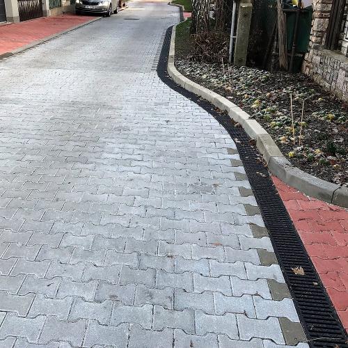 Odvodnění obytných zón bez podélného spádu v Praze 9 žlaby MEA