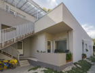 Na svazích Bělé pod Bezdězem se bělají bytové domy z Ytongu