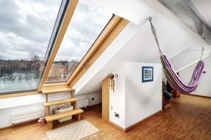Posuvné střešní dveře, střešní byt, Praha-Dejvice