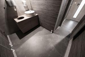 Café Smile, Brno – Systém Metalufloor zde je použit v celém interiéru včetně toalet