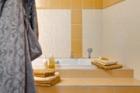 Obklady a dlažby značky RAKO v bytových domech Triplex
